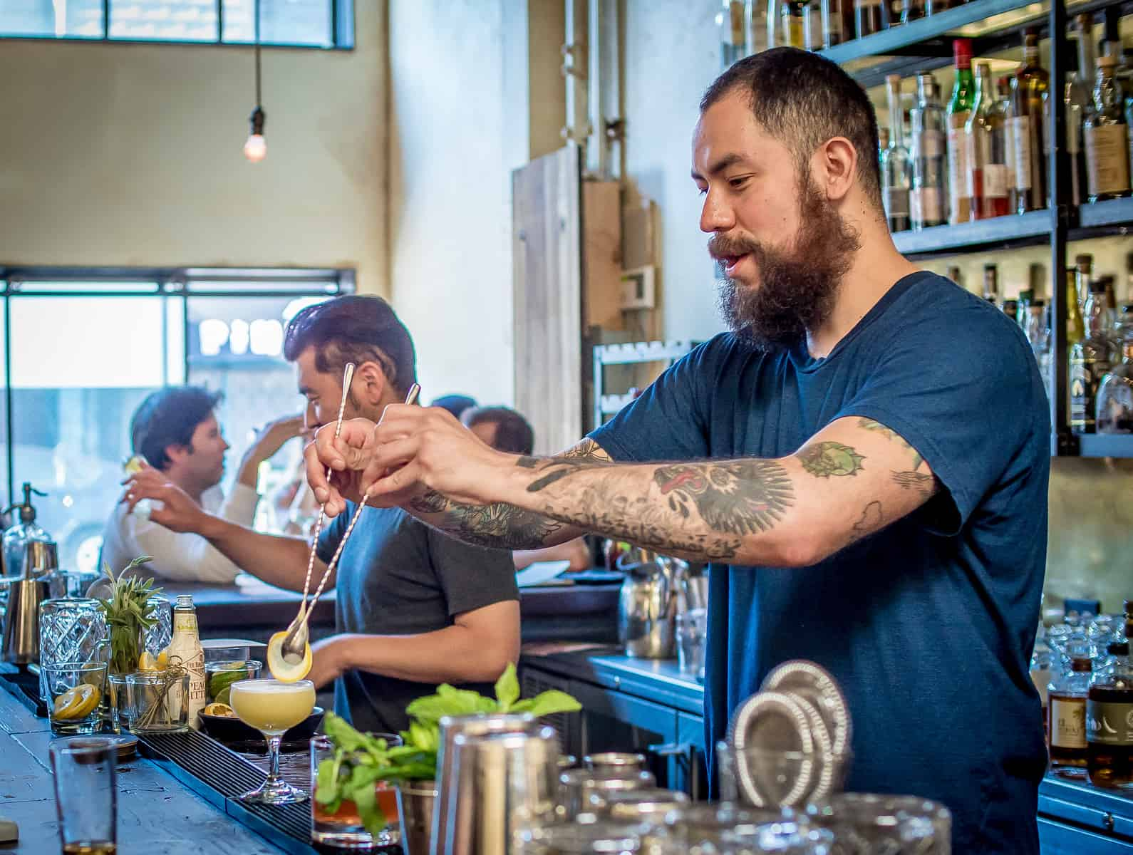 """Bartender Hector Valencia garnishes a cocktail at Alembic in San Francisco, Calif., on September 5th, 2015."""